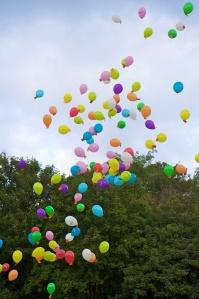 helium ballons in sky